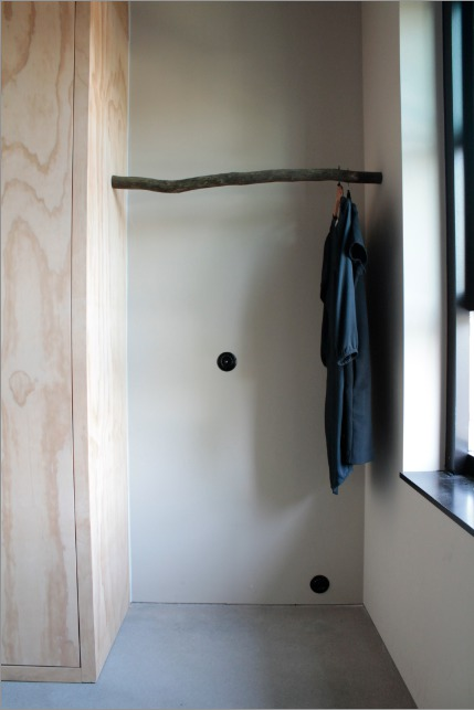 Wardrobe made of Finnish plywood and a found branch