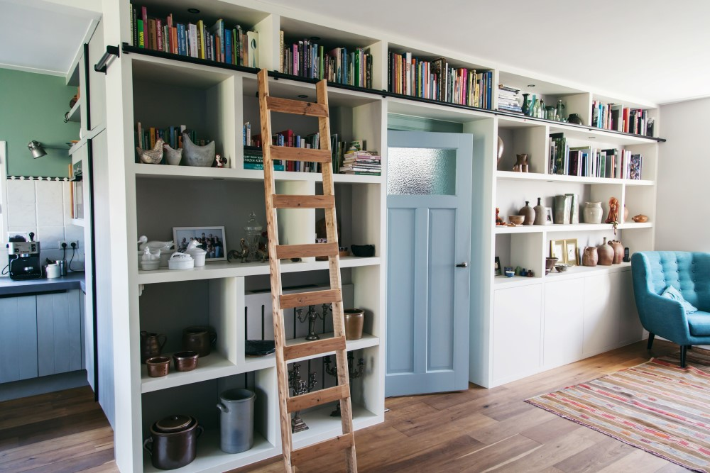 Living room cabinet with old-fashioned library staircase