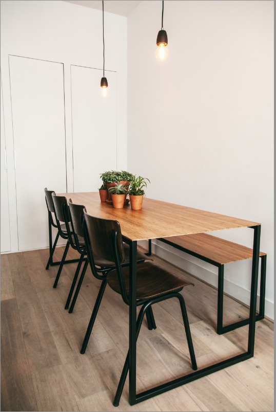 Dining table made from bamboo with  matt black frame.