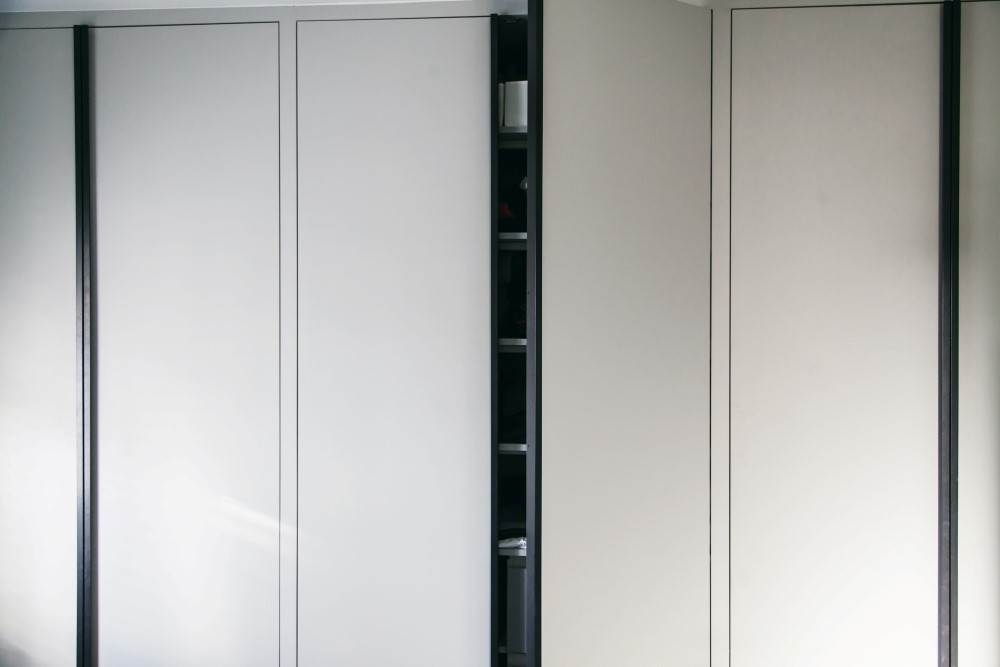 Wardrobe made of MDF with matt black steel handles