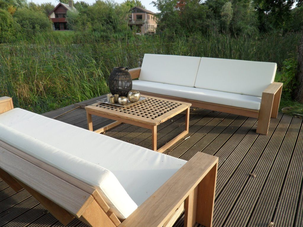 Lounge sofa made from from hardwood with custom made cushions