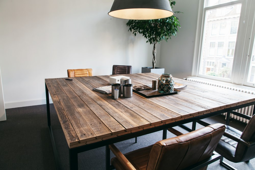 Meeting table made of old wood and a robust steel frame