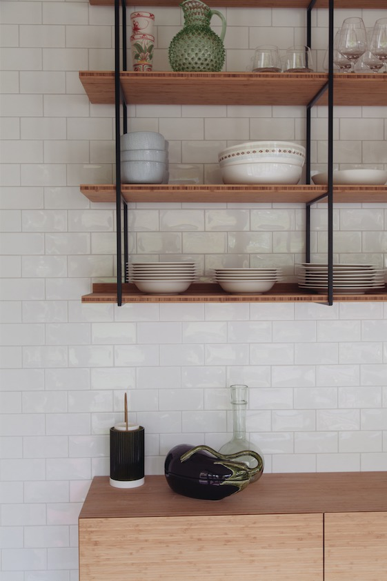 kitchen cabinet made of bamboo with a  matt black frame
