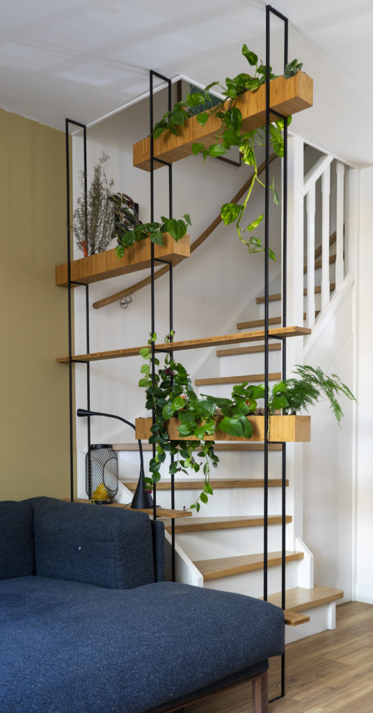 hanging garden made of bamboo with a matt black frame