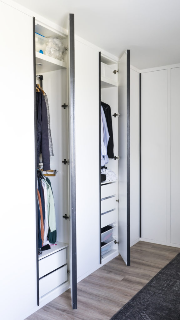 In the wardrobe are  drawers and pull-out wardrobe rods