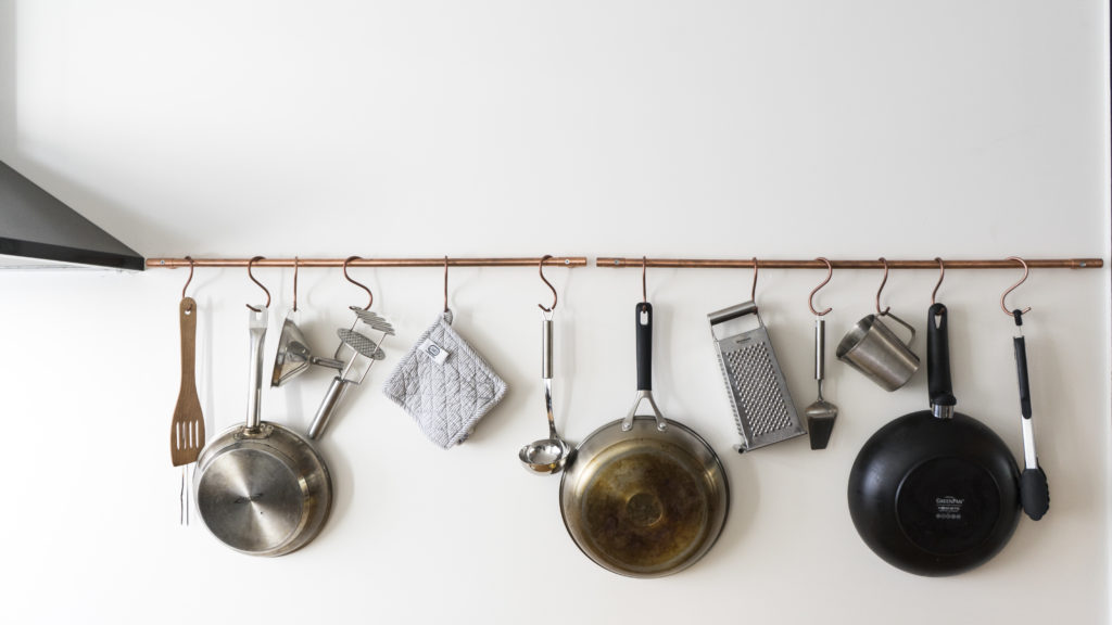 The incorrectly produced handles now serve as a pan rack