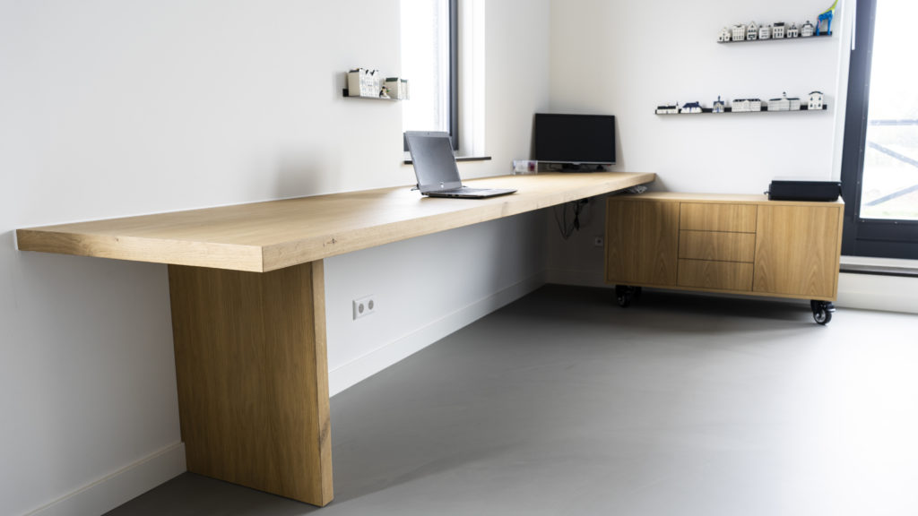 Desk with matching furniture on wheels.