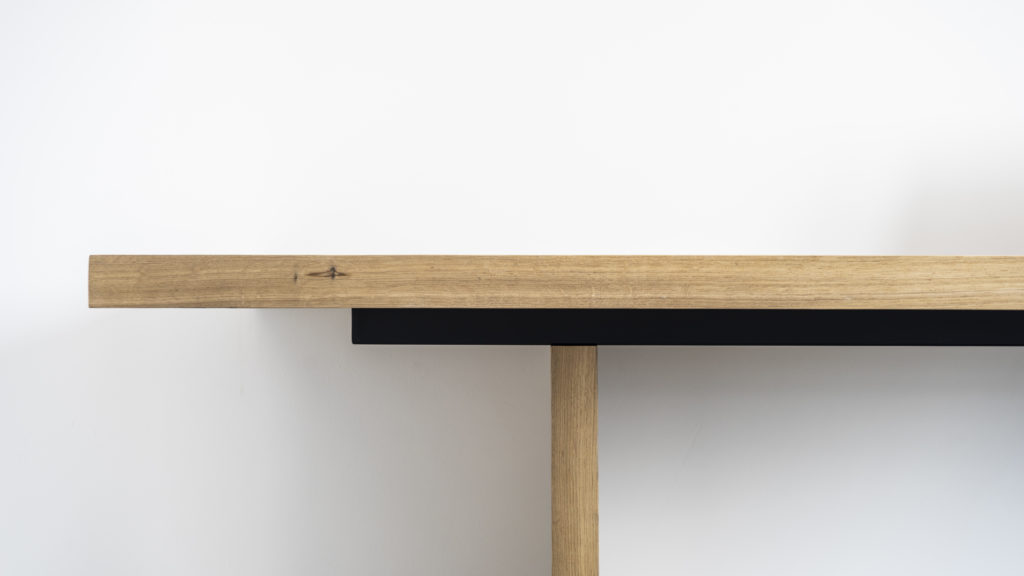 Desk made of oak, with a steel support.