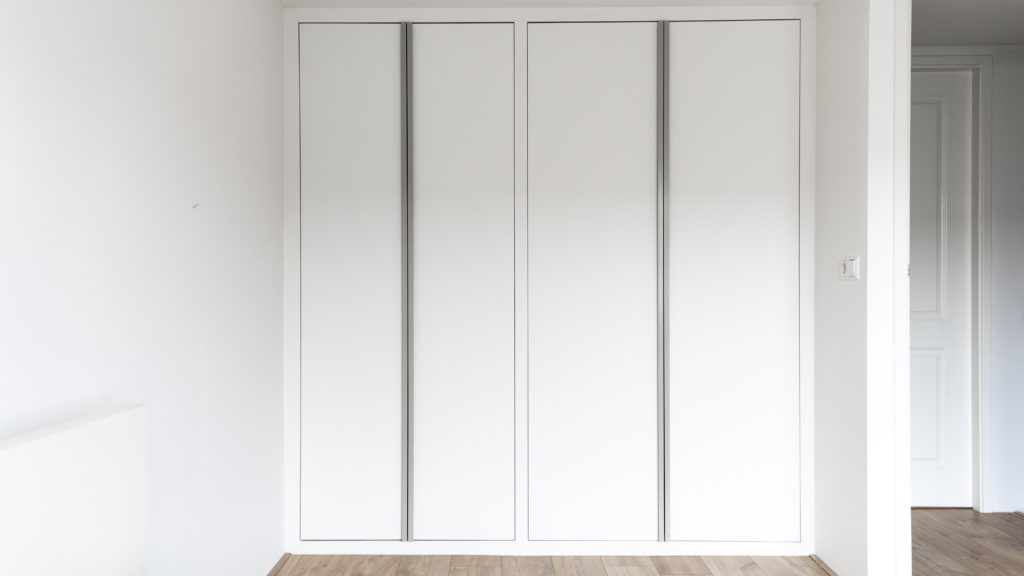Wardrobe made from lacquered MDF with steel handles.