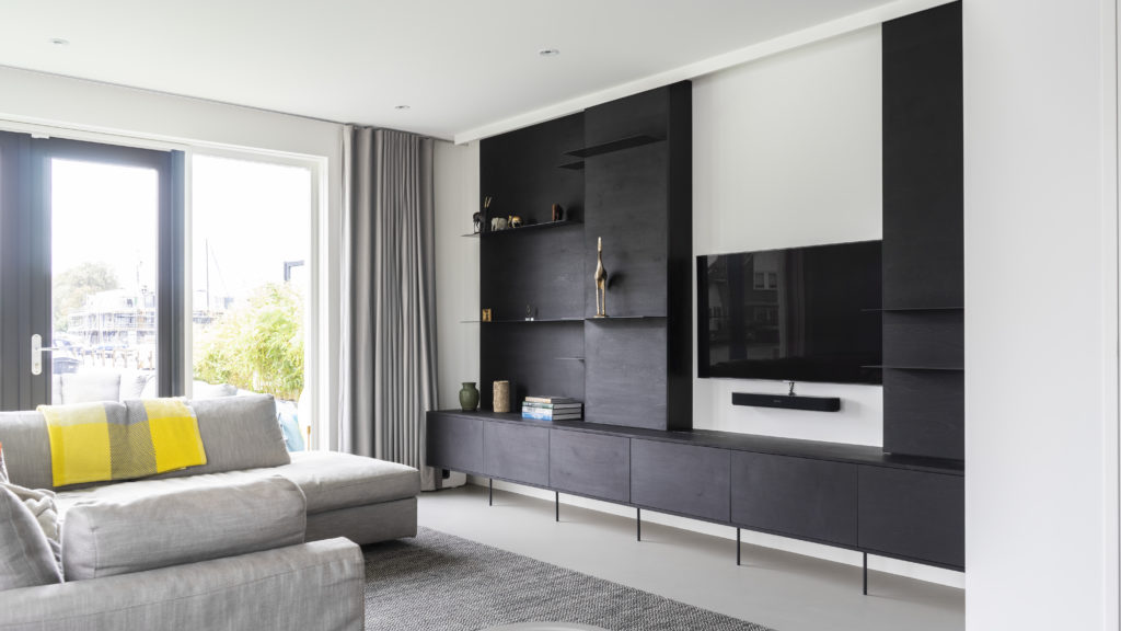 Living room cabinet with sliding doors, made of black-stained finnish plywood
